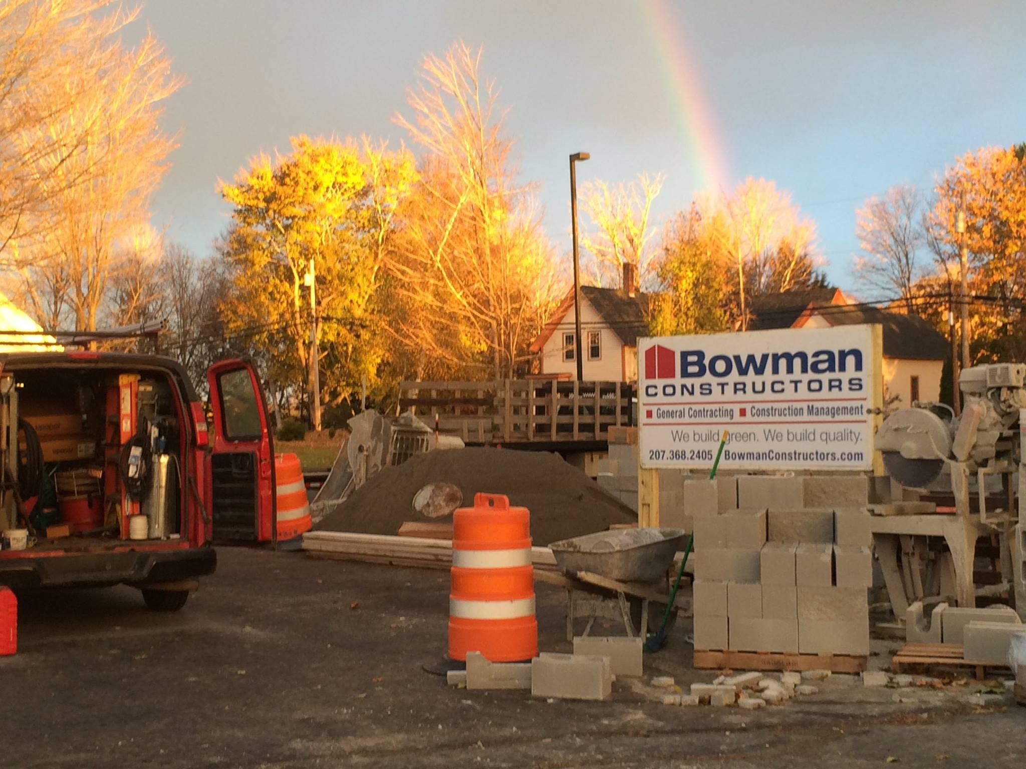 photo of rainbow over bowman constructors sign