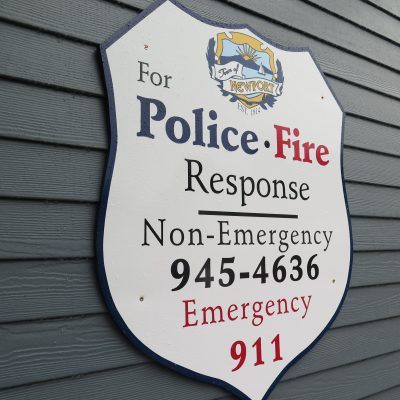 external photo of sign for police fire response non-emergency 945-4636 emergency 911 at newport public safety building