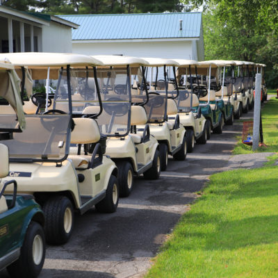 photo of golf carts lined up at sebasticook valley fcu golf tournament