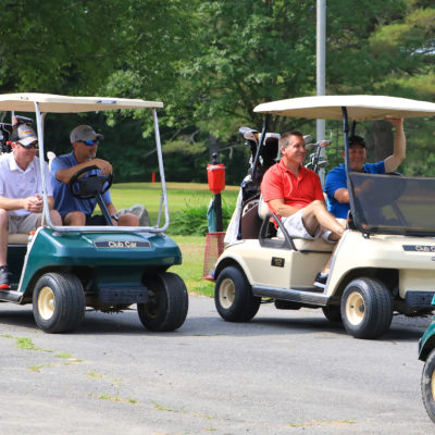 photo of full golf carts sitting at sebasticook valley FCU golf tournament