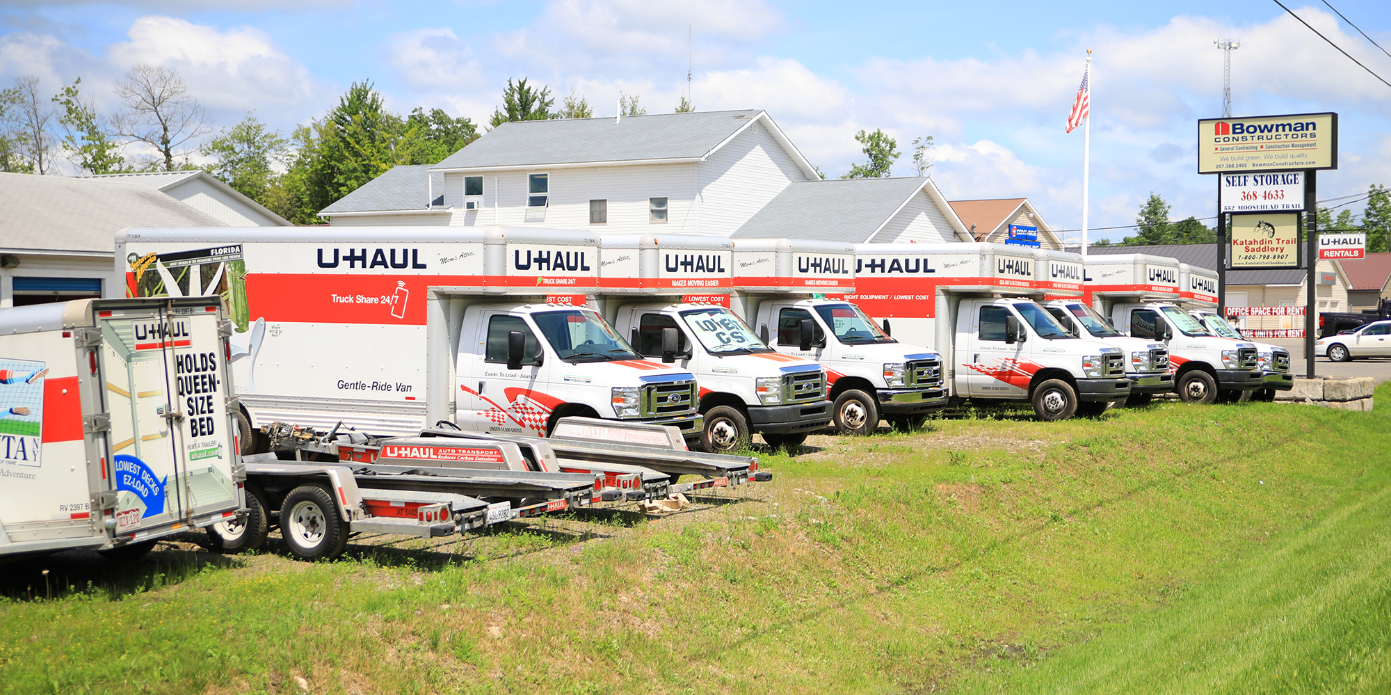photo of uhaul fleet of trucks at bowman constructors