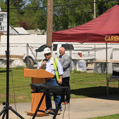 photo of kevin speaking at caribou community school beam signing ceremony