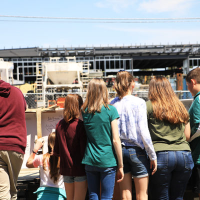 photo of students signing beam at caribou community school beam signing ceremony