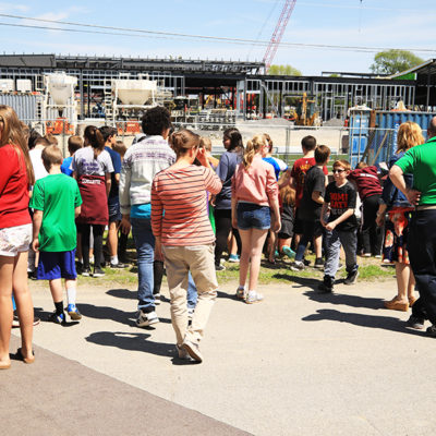 photo of students and parents standing outside construction zone at caribou community school beam signing ceremony