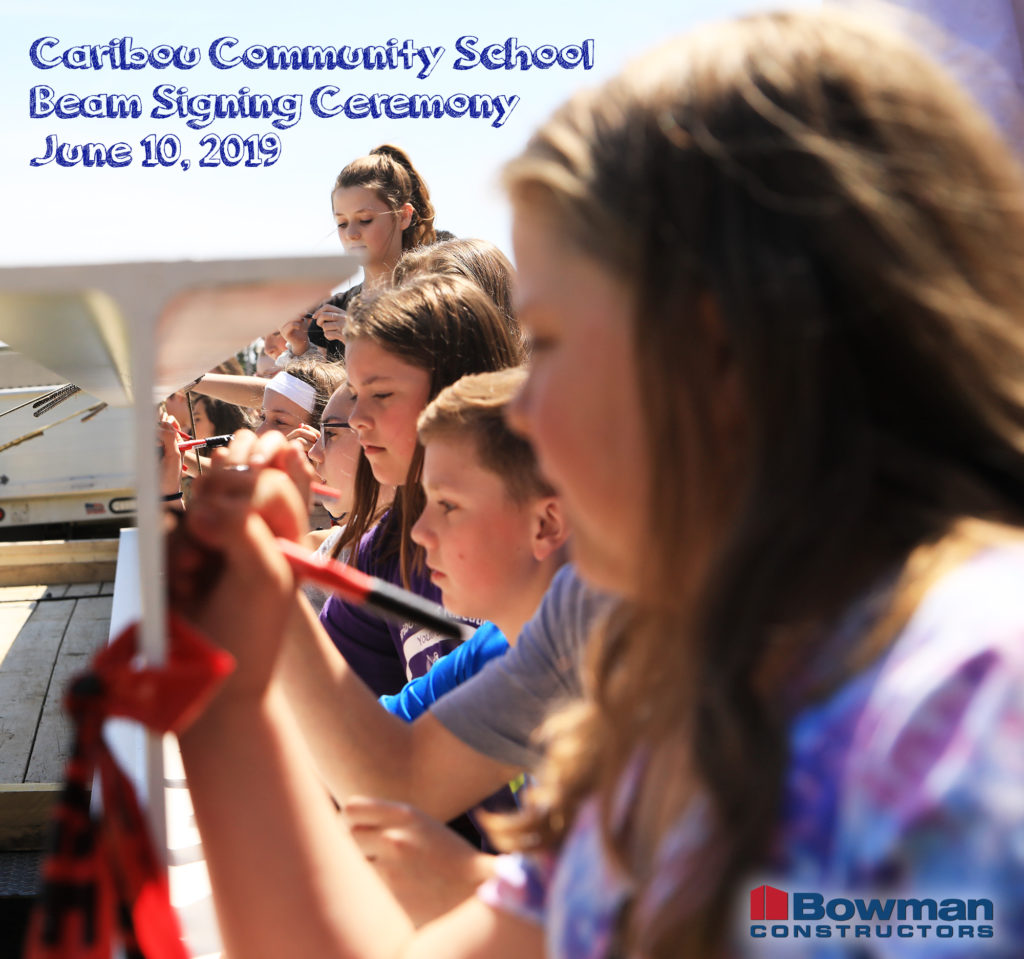 photo graphic of caribou community school beam signing ceremony june 10, 2019 students signing beam