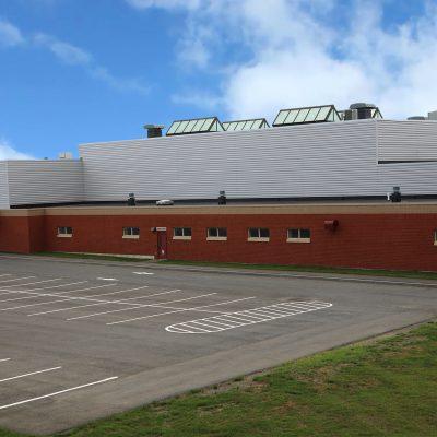 external photo of parking lot at ashland school building
