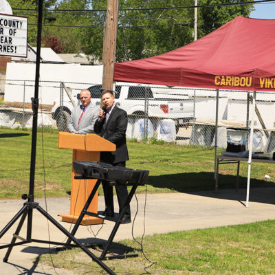 photo of principal speaking at caribou community school beam signing ceremony
