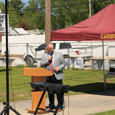 photo of tim speaking at caribou community school beam signing ceremony