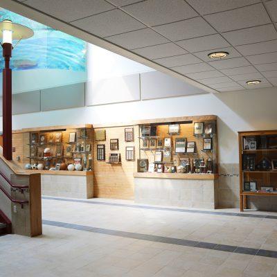 internal photo of trophy case at ashland school building
