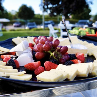 photo of cheese and fruit platter on table outside