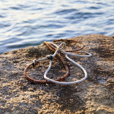 photo of ropes on rockland stone breakwater walkway