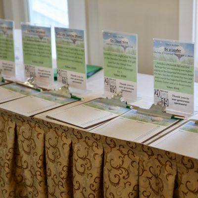 photo of silent auction sign and clipboards